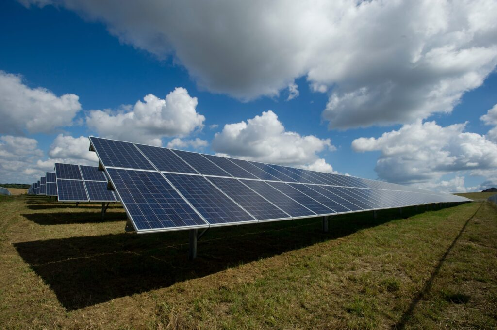 Picture is showing a solar panels in the field